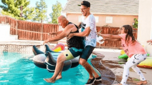Guy pushing old man in the pool